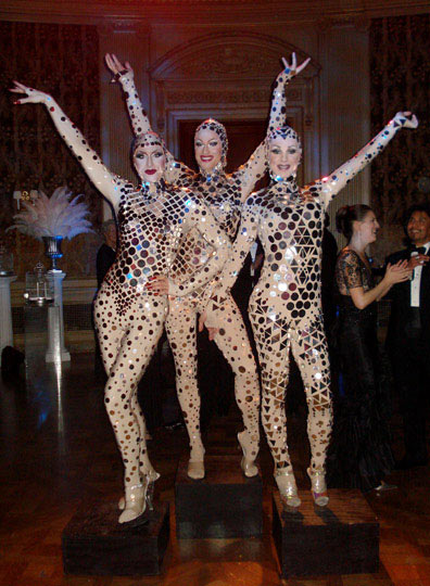 Here's some humans dressed as disco balls